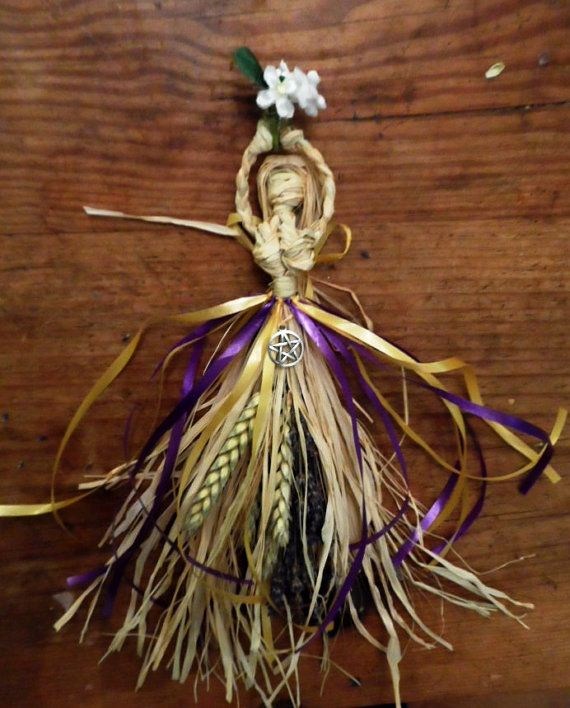 Showing a handmade Corn Doll of the Goddess Brighid